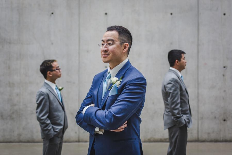 calgary chinese wedding photographers sait garage parking lot groom blue suit