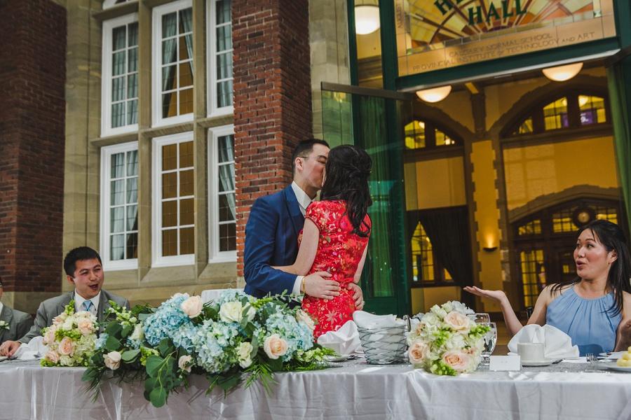 calgary chinese wedding photographers sait heritage hall bride groom kiss