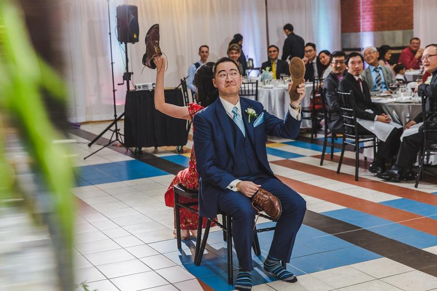 calgary chinese wedding photographers sait heritage hall shoe game groom