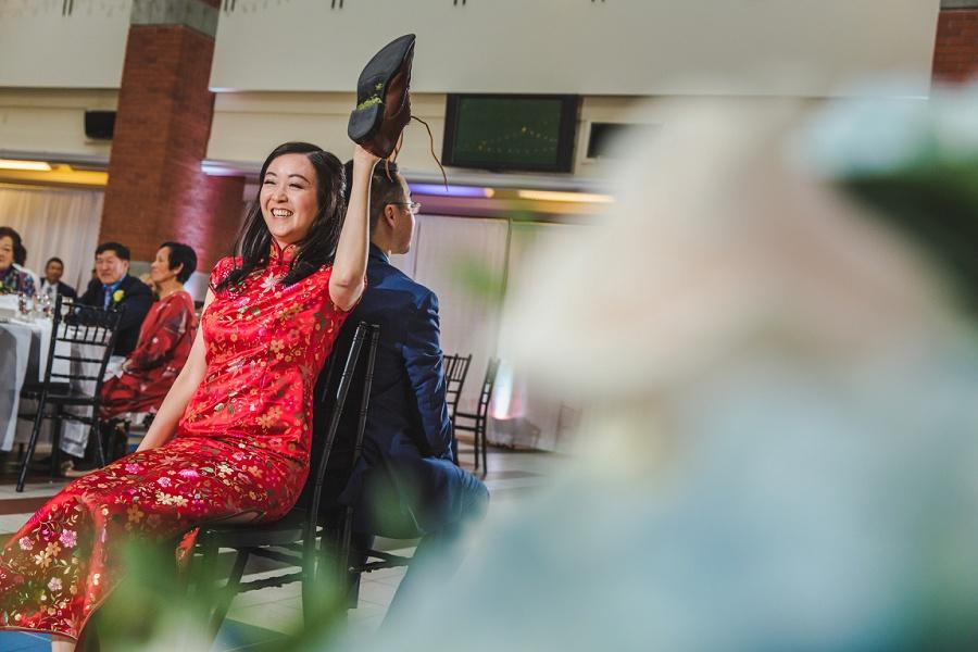 calgary chinese wedding photographers sait heritage hall shoe game bride