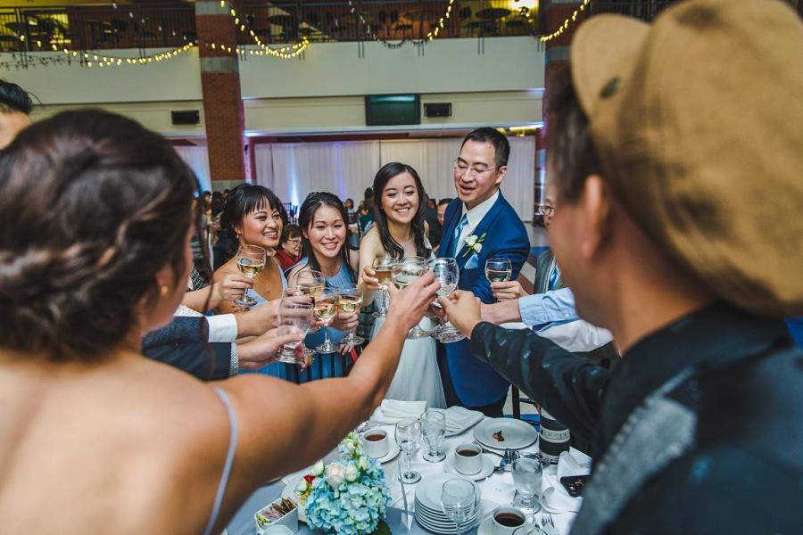 calgary chinese wedding photographers sait heritage hall bride groom champagne toast