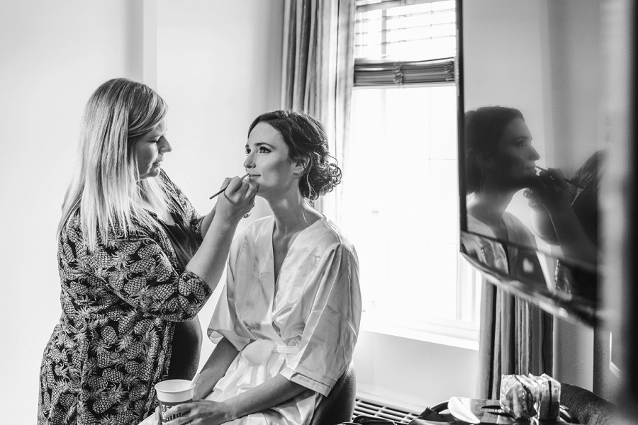 calgary wedding photographer bride getting ready makeup artist