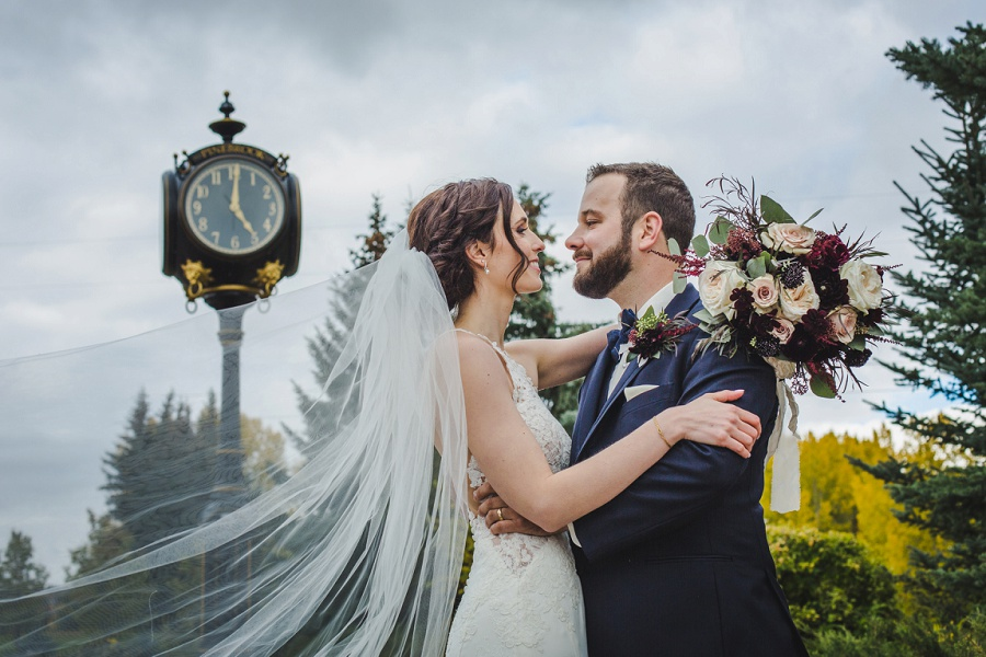 calgary pinebrook golf and country club wedding large clock long bridal veil