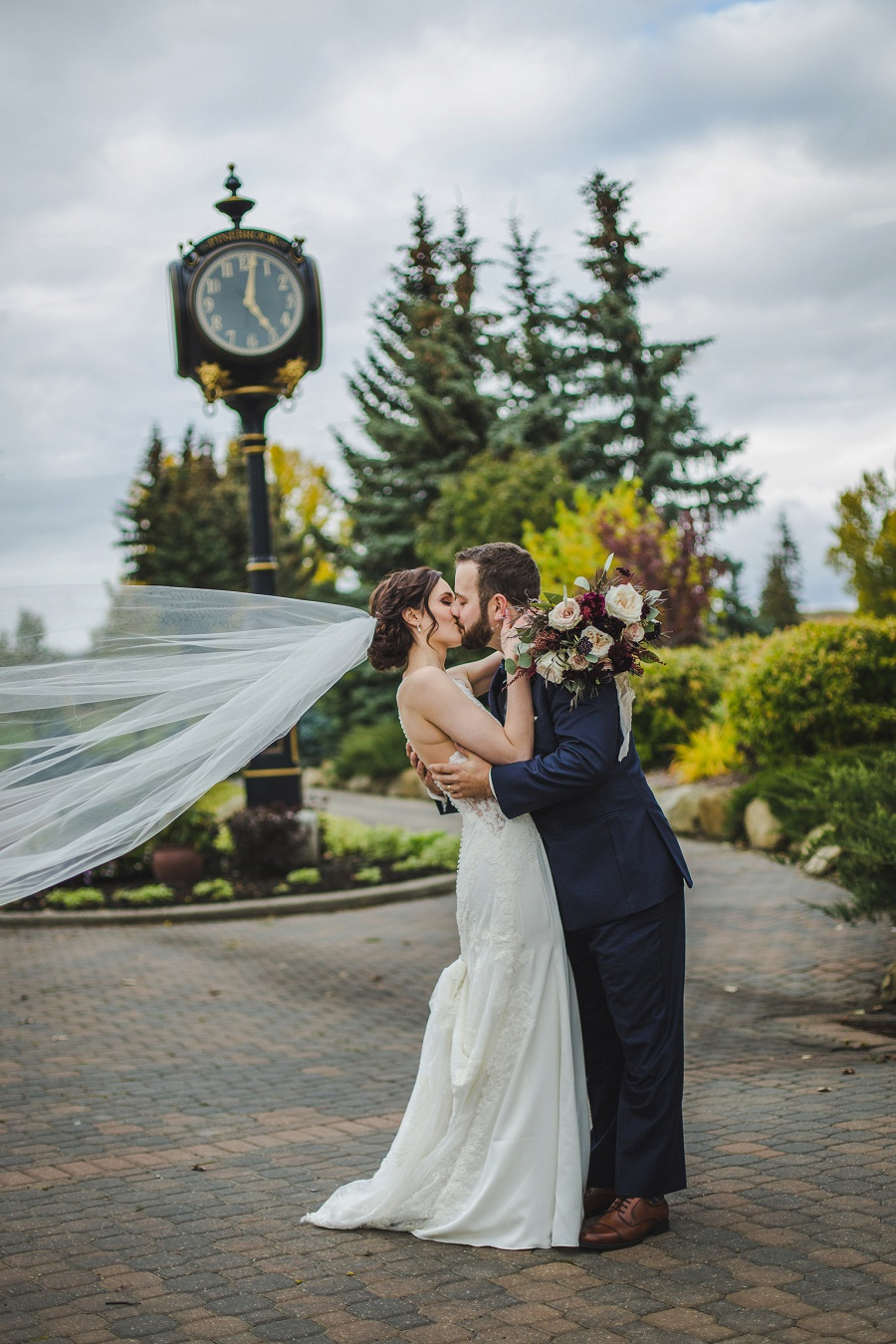 calgary pinebrook golf and country club wedding outdoor clock bridal veil blue suit