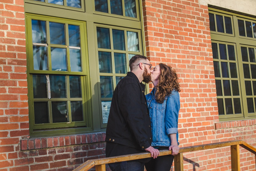 calgary east village simmons building engagement photos red brick kiss