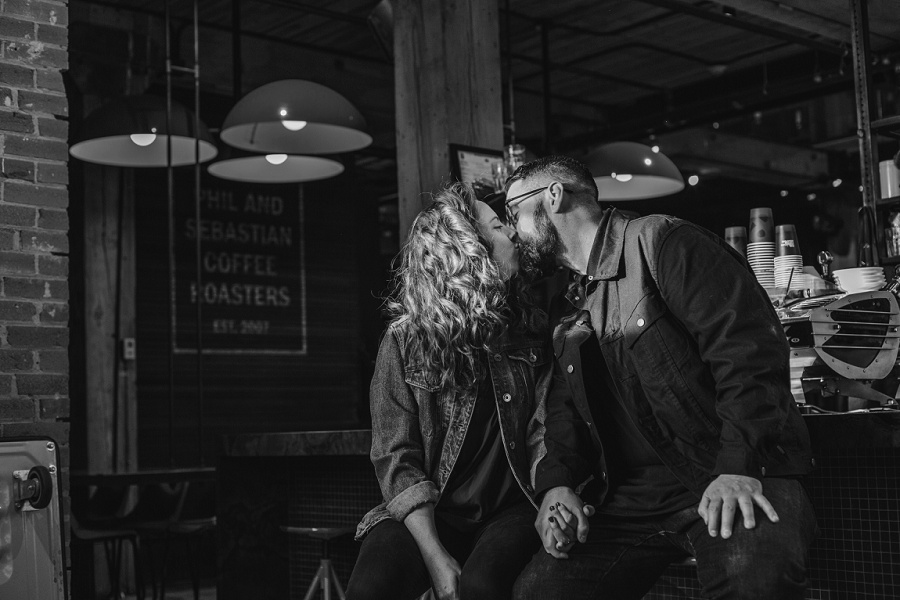 calgary east village simmons building engagement photos couple kiss